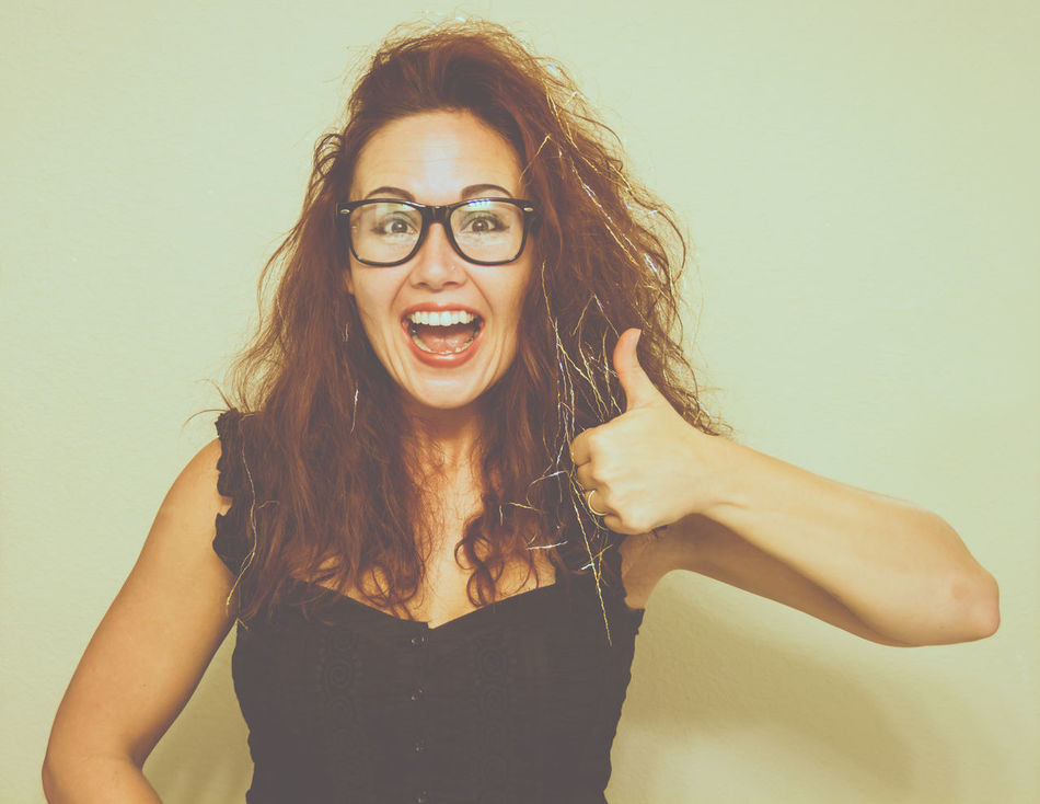 Approval Beauty Big Smile Cheerful Elation Eyeglasses  Female Glasses I Joy Long Hair Okay One Person One Woman Only One Young Woman Only Person Portrait Progress Real People Smiling Studio Shot Thumbs Up Woman Yes Young Adult