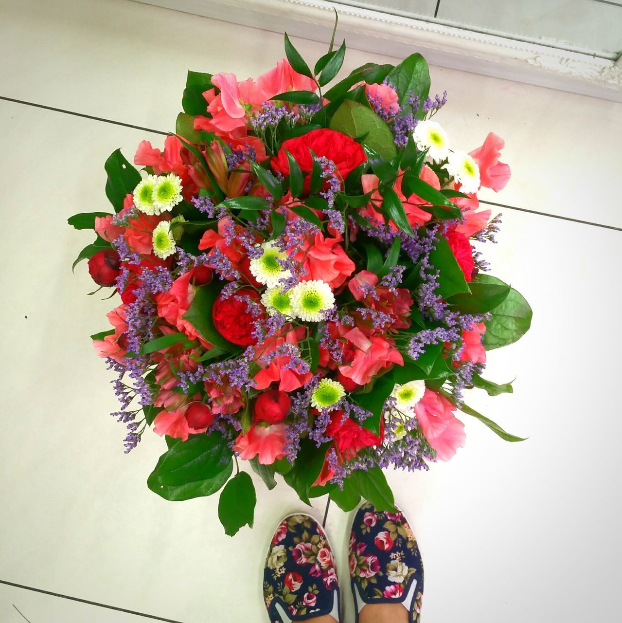 flower, red, growth, freshness, leaf, fragility, beauty in nature, nature, rose - flower, petal, vase, plant, potted plant, indoors, flower head, no people, close-up, day