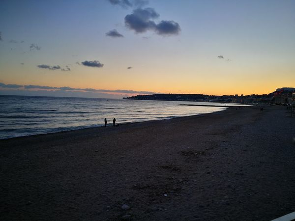 Nofilter Beach Sunset Sea Sky Sand Outdoors Horizon Over Water People Large Group Of People Scenics Beauty In Nature Vacations Nature Only Men Adults Only Adult Day