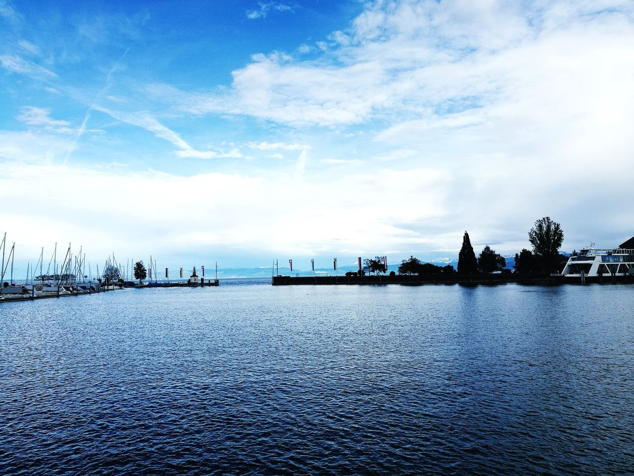 sky, water, waterfront, cloud - sky, river, outdoors, no people, architecture, city, built structure, rippled, nautical vessel, day, building exterior, beauty in nature, scenics, nature, harbor, cityscape