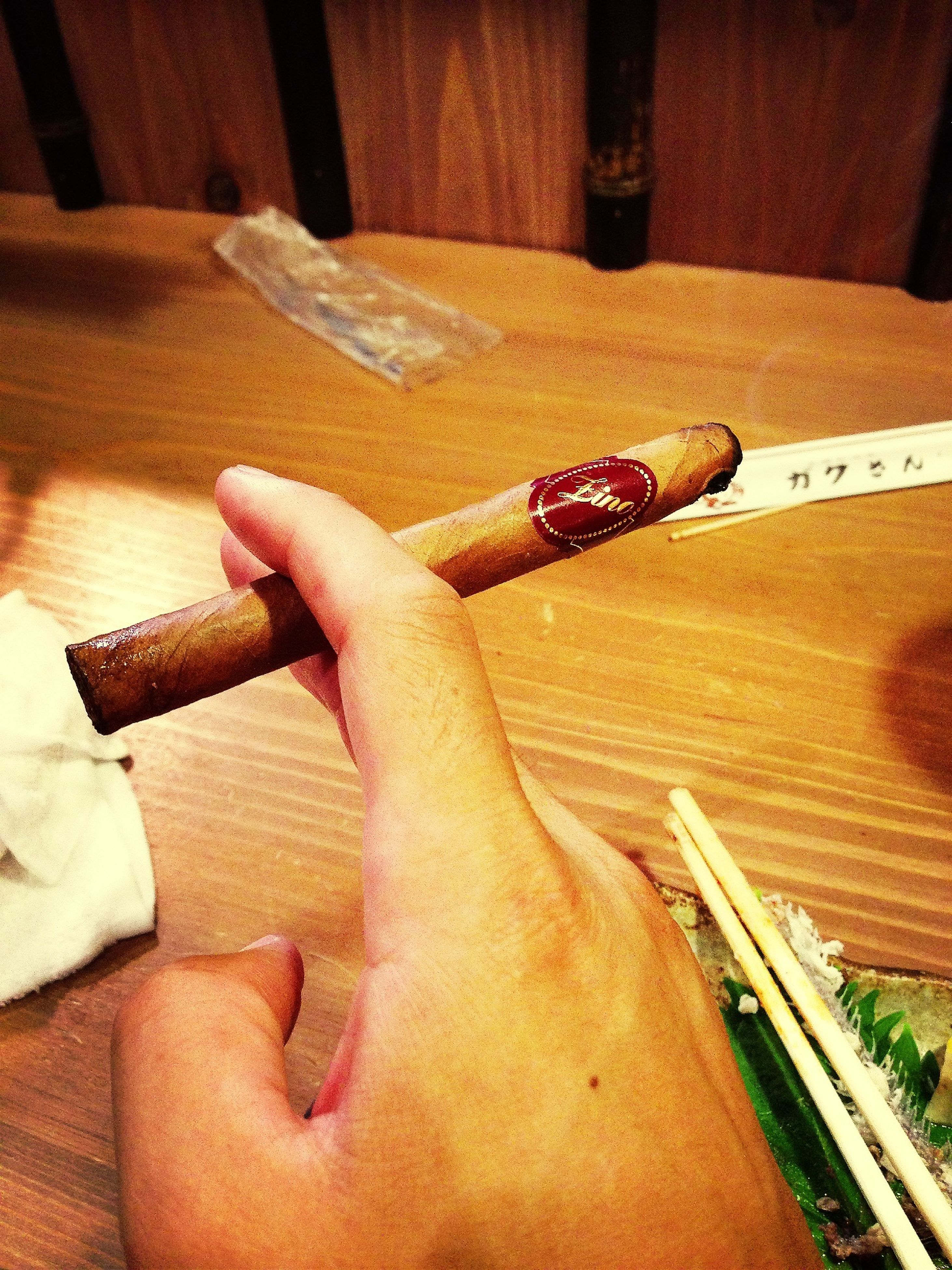person, indoors, part of, holding, cropped, lifestyles, human finger, leisure activity, close-up, personal perspective, wood - material, unrecognizable person, high angle view, table, men