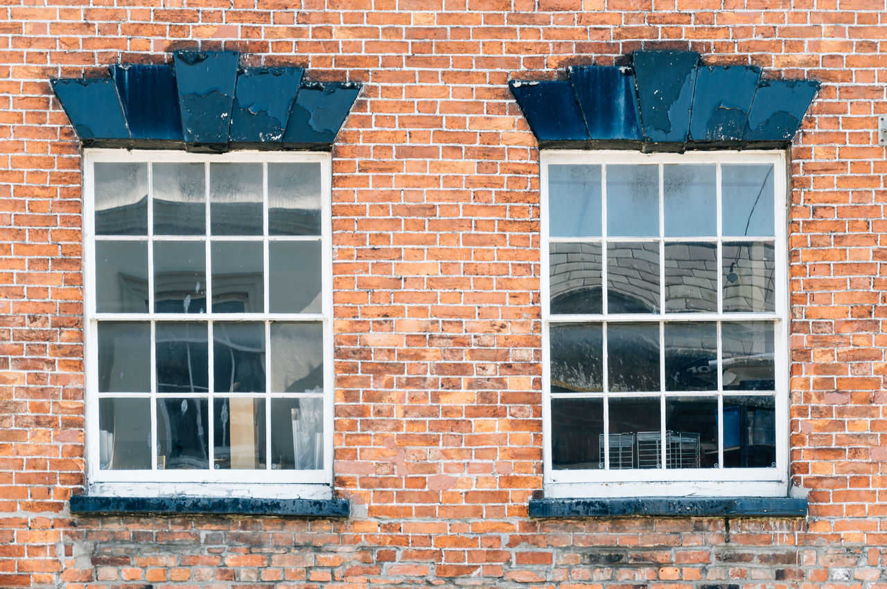 Two windows on a brick wall Aged Architecture Backgrounds Brick Brick Wall Building Building Exterior Built Structure City Day Detail Exterior Full Frame Geometry No People Outdoors Taking Photos Two Urban Urban Geometry Vintage Wall Window