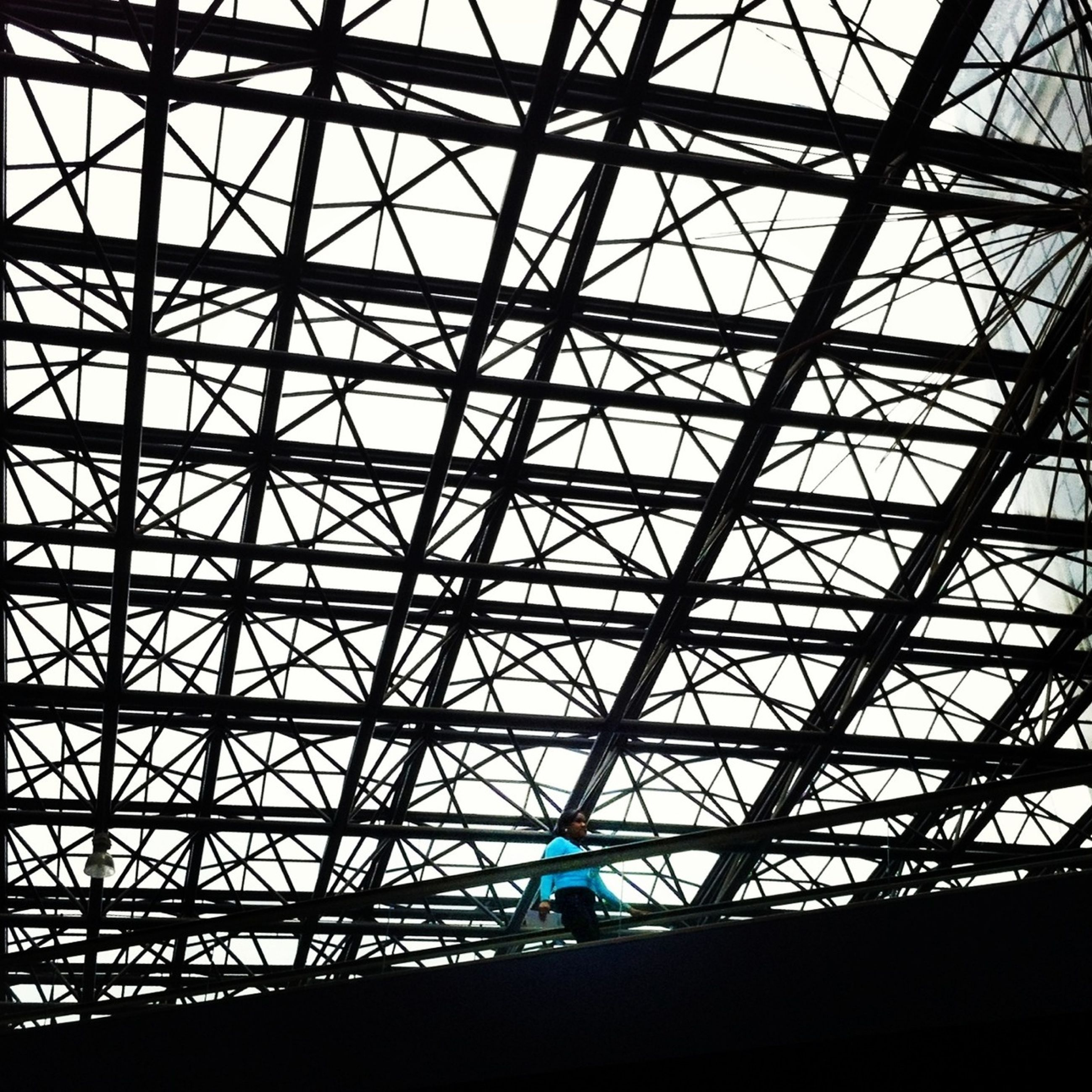 low angle view, built structure, silhouette, architecture, metal, sky, ceiling, connection, grid, pattern, indoors, metallic, no people, directly below, backgrounds, transportation, geometric shape, full frame, day, architectural feature