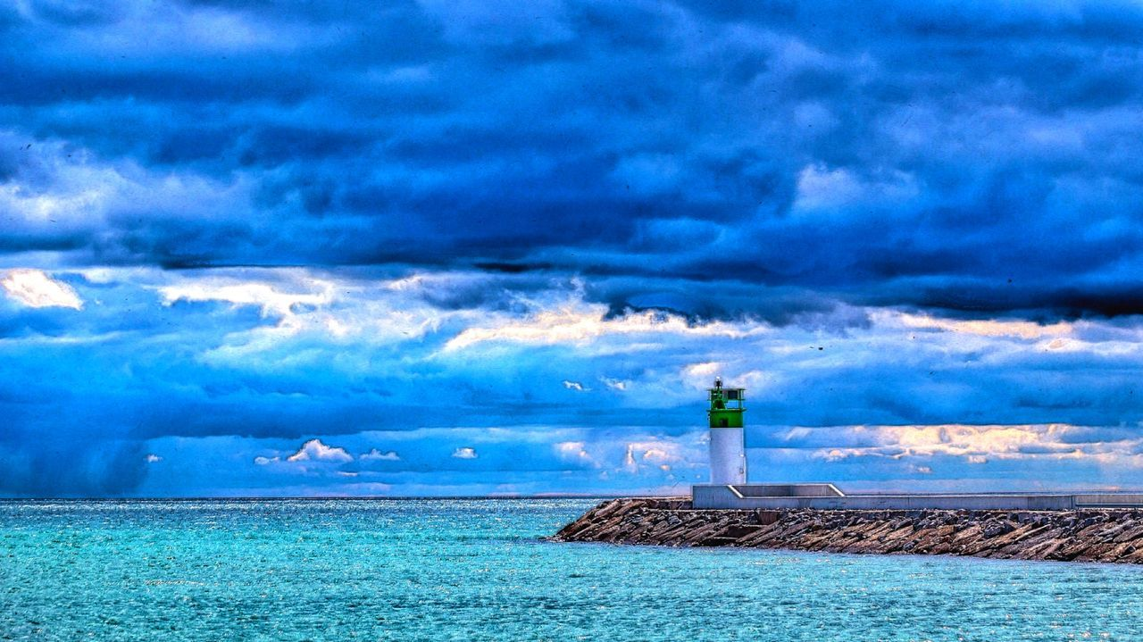 lighthouse, cloud - sky, sky, sea, water, guidance, direction, safety, horizon over water, day, protection, nature, scenics, beauty in nature, blue, outdoors, built structure, no people, building exterior, architecture, nautical equipment