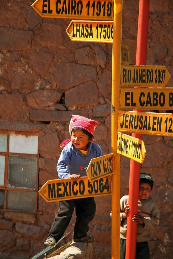 Taquile Taquile Island Peru Tradition Charts Direction Directions Where Do I Go? Where To Go? Child Playing Cities Headed Out Childhood