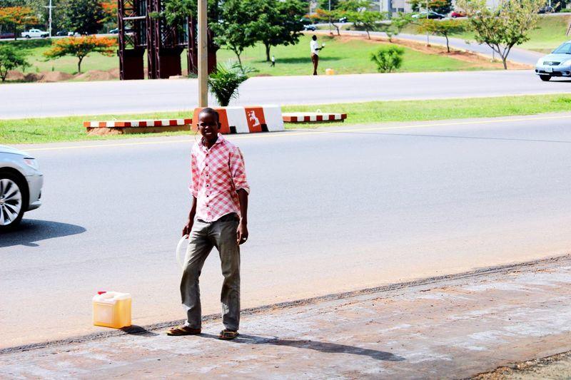 Menatwork Fuelscarcity Hustlers Abuja Nigeria AbujaPhotographer Blackmarket Work Working Hard Streetphotography Canon600D Hawking Taking Photos Canonphotography