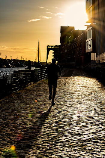 runner Afternoon Light Backlight Elbe River Hamburg Harbour Sky And Clouds Afternoon Sun Buildings Architecture Lens Flares Paving Stones Runner Sun Sunlight And Shadow Water
