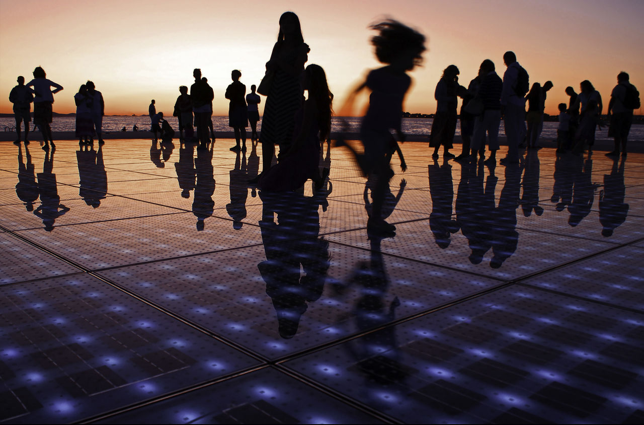 Multi-award winning photograph featured in Guardian, multiple international magazines and book cover. Taken in July 2009 at Zadar Pier, Croatia at the Monument to the Sun (Pozdrav Suncu), architect Nikola Basic. The monument consists of 300 solar panels which emit light patterns at sunset. More images at ivodukic.com Carbon Footprint Children Playing City Life Clean Climate Climate Change Climatechange Croatia Croatia ♡ Cropped Energy Environment Future Hrvatska Large Group Of People Monument To The Sun Nikola Basic Pier Play Pozdrav Suncu Reflection Solar Panels Sunset Tourism Zadar