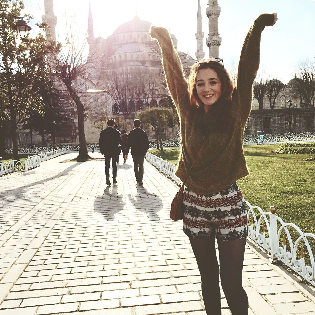Beautiful stock photos of globe of earth, Arms Raised, Blouse, Brown Hair, Building Exterior