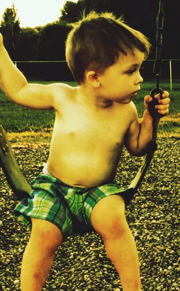 Deep In Thought Young Boy Big Dreams Young Boy Big World Swingswingswings Playtime... Playground Life