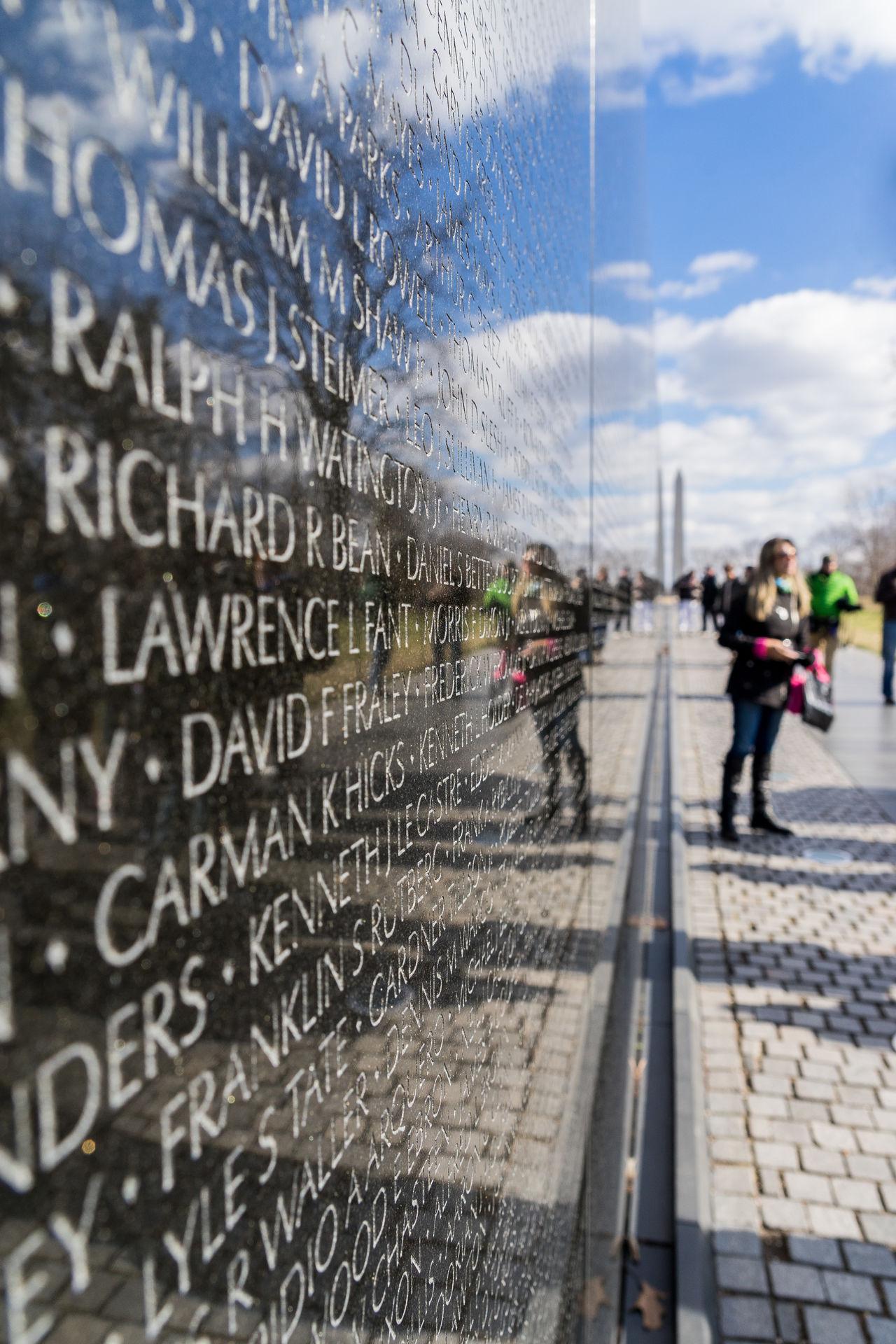 America Capital Cities  D.C. Day Fallen Hand Memorial Names Reflections Sightseeing Soldier USA Vietnam Vietnam War Memorial Wall War Washinton The City Light Washington, D. C.