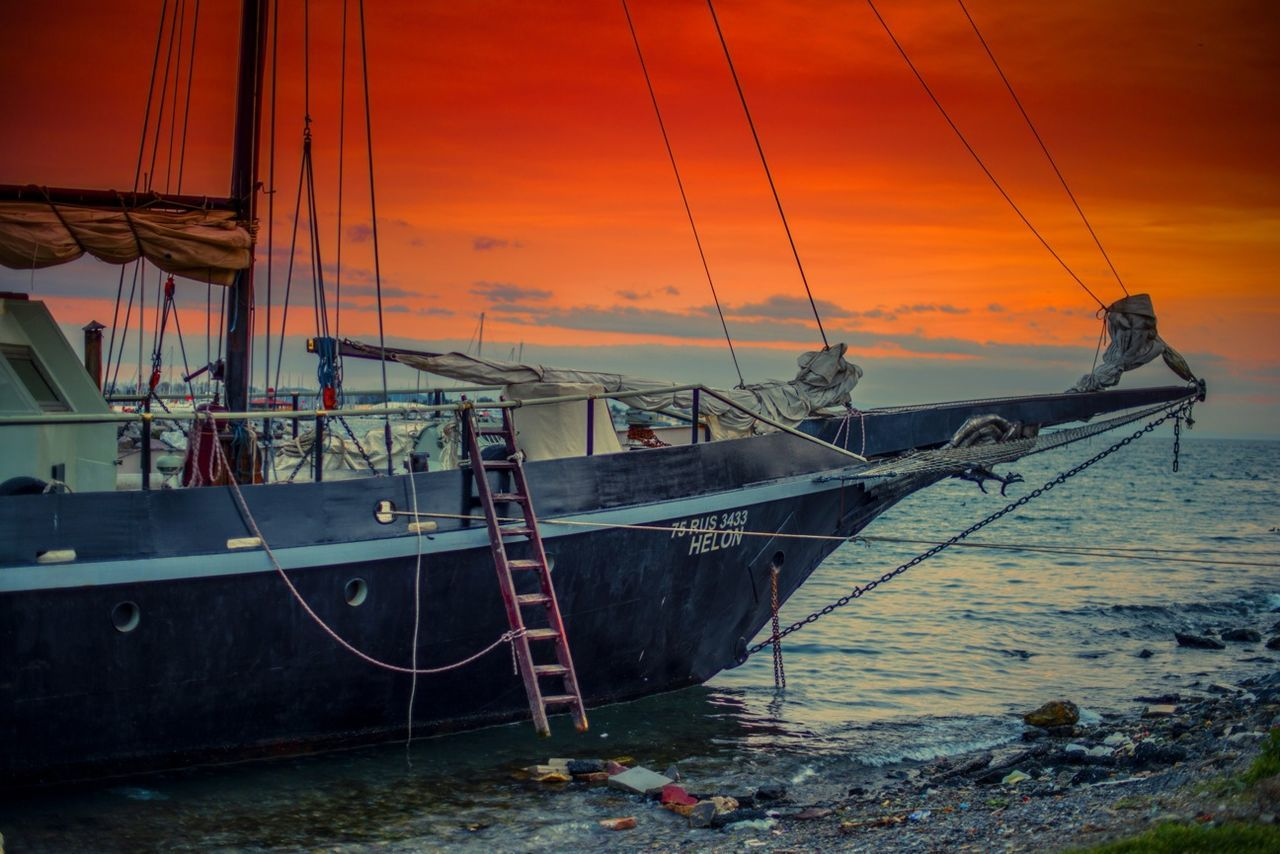 nautical vessel, sunset, transportation, sea, mode of transport, boat, water, mast, sky, sailboat, cloud - sky, moored, ship, harbor, nature, cloud, scenics, dramatic sky, waterfront, sailing, outdoors, orange color, tranquility, fishing boat, shore, beauty in nature, sailing ship, ocean, mountain