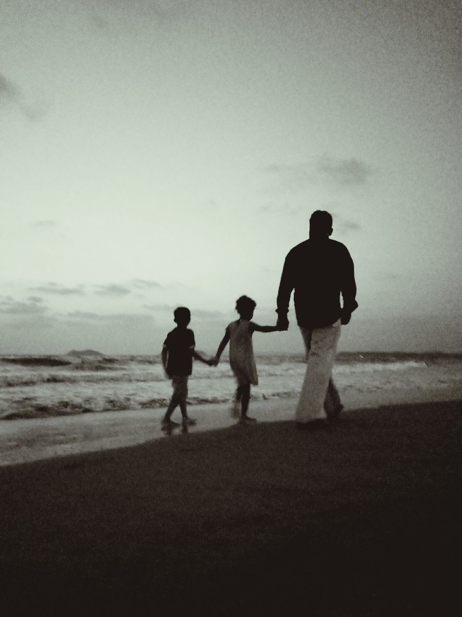 Silhouette Beach Sand Full Length Vacations Sea People Childhood Adult Child Togetherness Men Nature Outdoors Sky Day Beachtime Mature Adult Camera Life Is My Life! Adults Only Summer Real People Vacations Two People Walking On The Beach