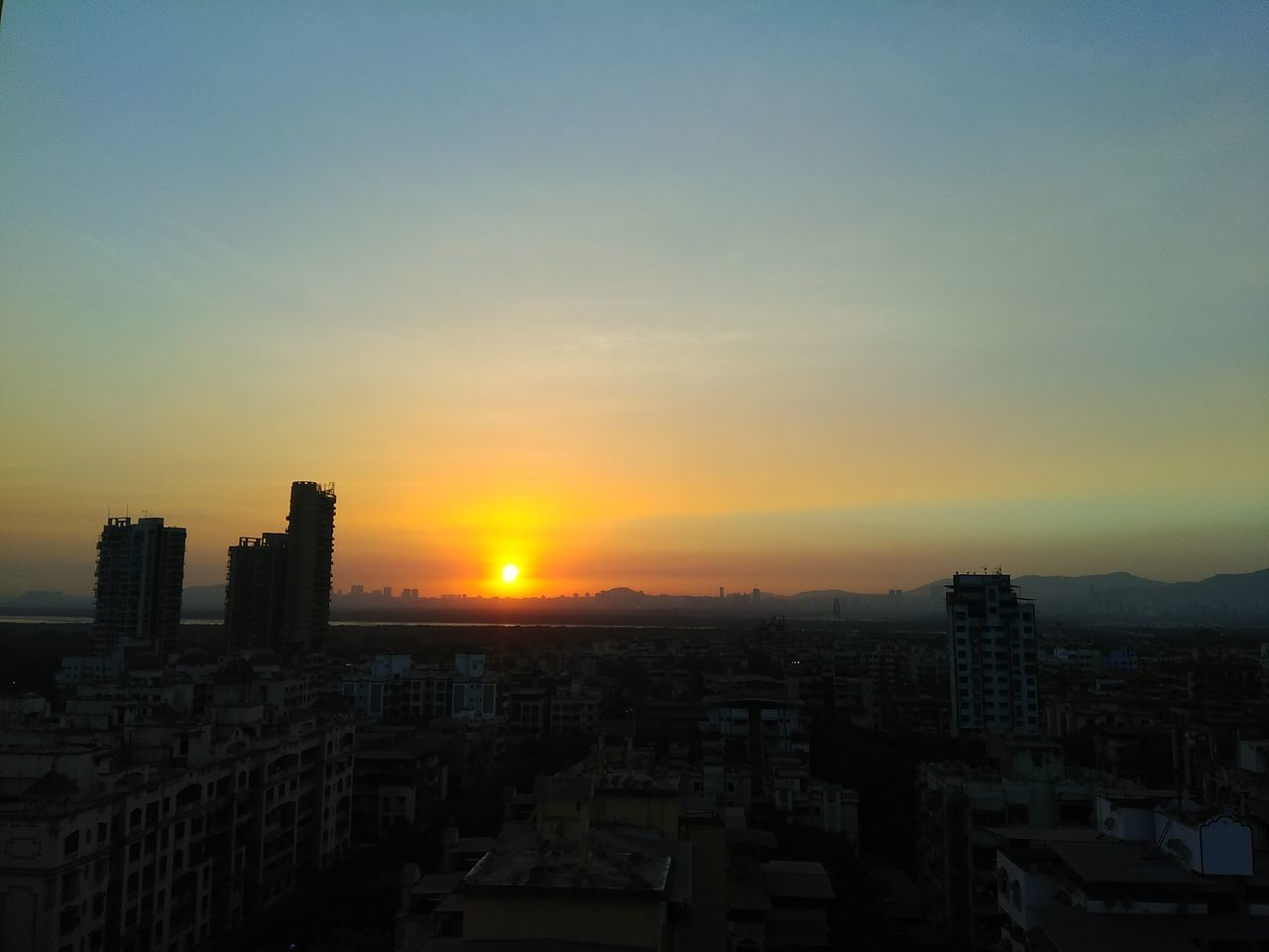 Cityscape Sunset Building Exterior City Architecture High Angle View Sky Urban Skyline Travel Destinations Skyscraper Built Structure Residential Building City Life Cloud - Sky Modern Outdoors No People Downtown District NoEdits  No Filter Cityscape Tower Top Calm Sky Awesome_sky