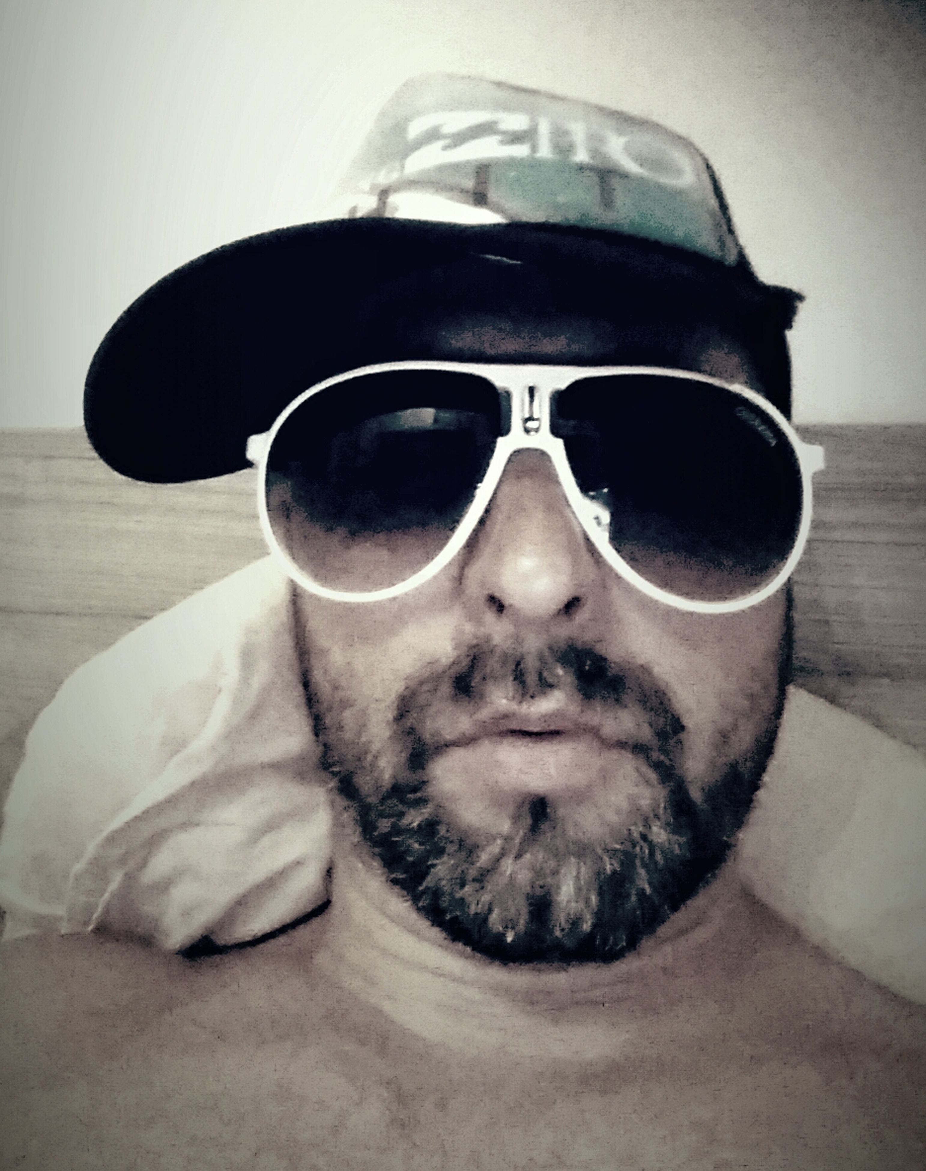 sunglasses, looking at camera, portrait, lifestyles, close-up, reflection, headshot, front view, eyeglasses, leisure activity, person, car, young adult, young men, mid adult men, transportation, indoors, beard