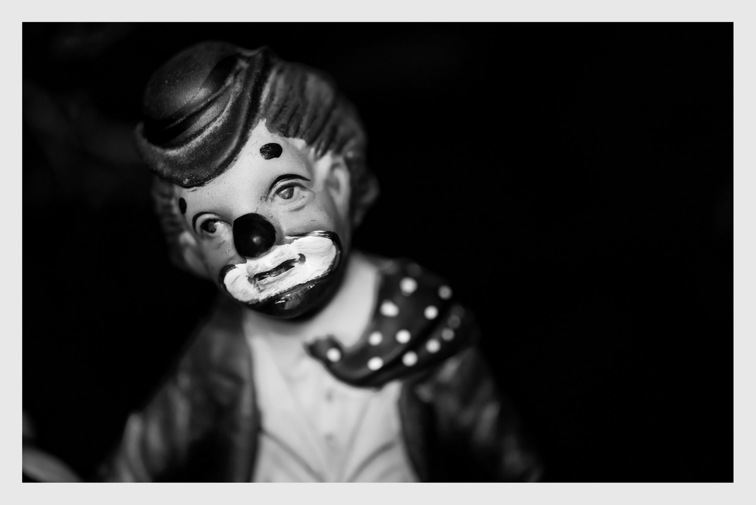 transfer print, auto post production filter, human representation, close-up, indoors, portrait, looking at camera, art, art and craft, selective focus, statue, copy space, front view, creativity, focus on foreground, animal representation, toy, studio shot, sculpture