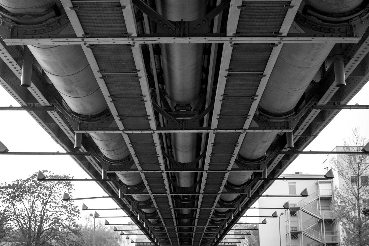 architecture, built structure, connection, metal, transportation, outdoors, day, building exterior, low angle view, underneath, no people, sky