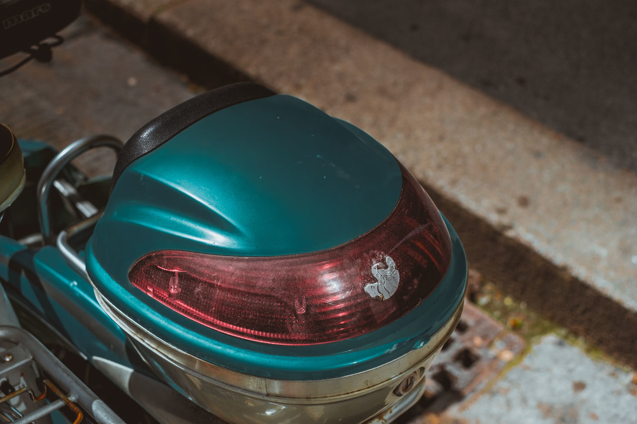 Close-up Day Details High Angle View Lines No People Outdoors Rear Of Scooter Red Reflector Scooter Scooter Case Street Background Streetphotography Turquoise Colored