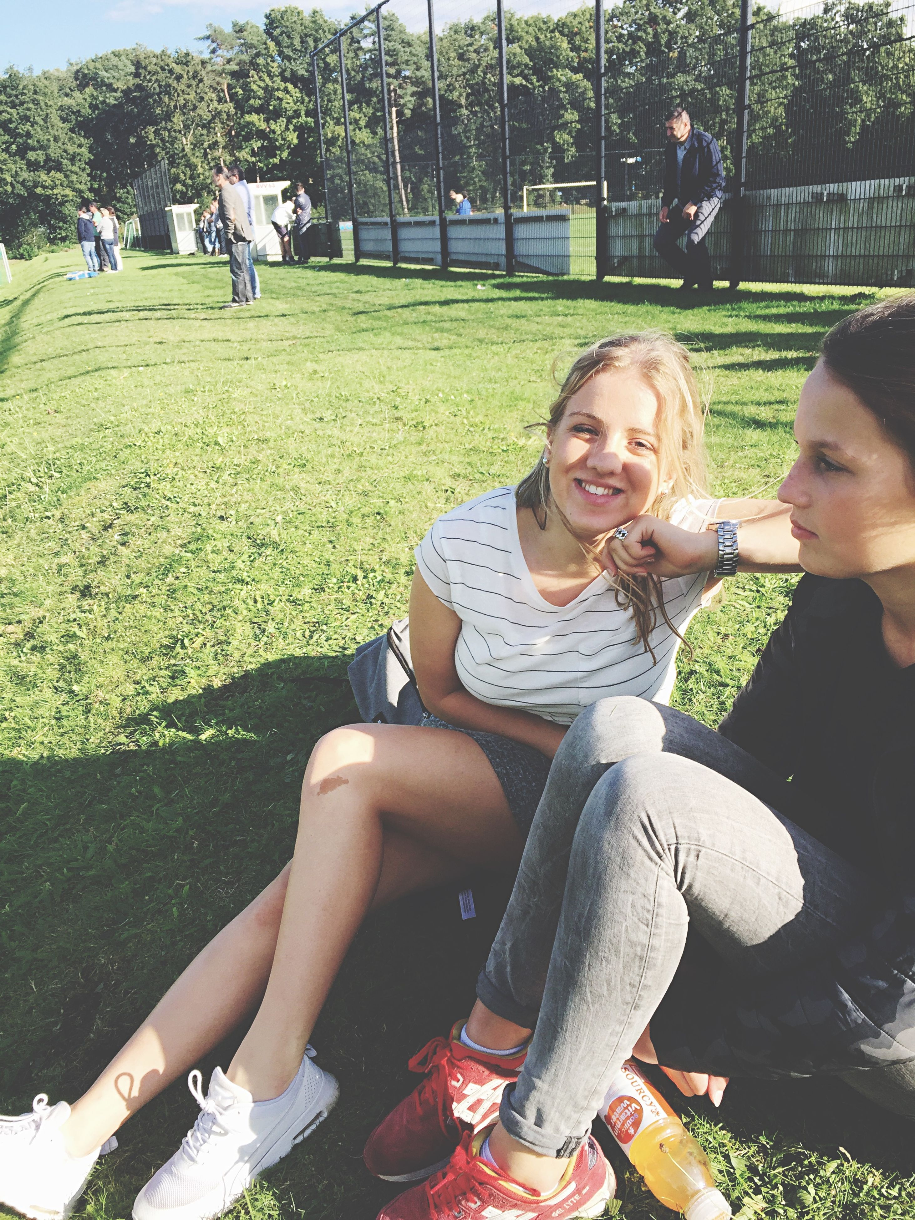 lifestyles, leisure activity, person, casual clothing, sitting, togetherness, smiling, bonding, happiness, young adult, childhood, enjoyment, park - man made space, love, portrait, young women, looking at camera