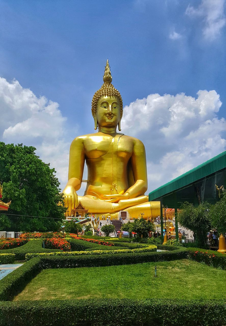 statue, sculpture, male likeness, human representation, religion, spirituality, idol, golden color, art and craft, sky, low angle view, grass, gold colored, no people, day, nature, outdoors