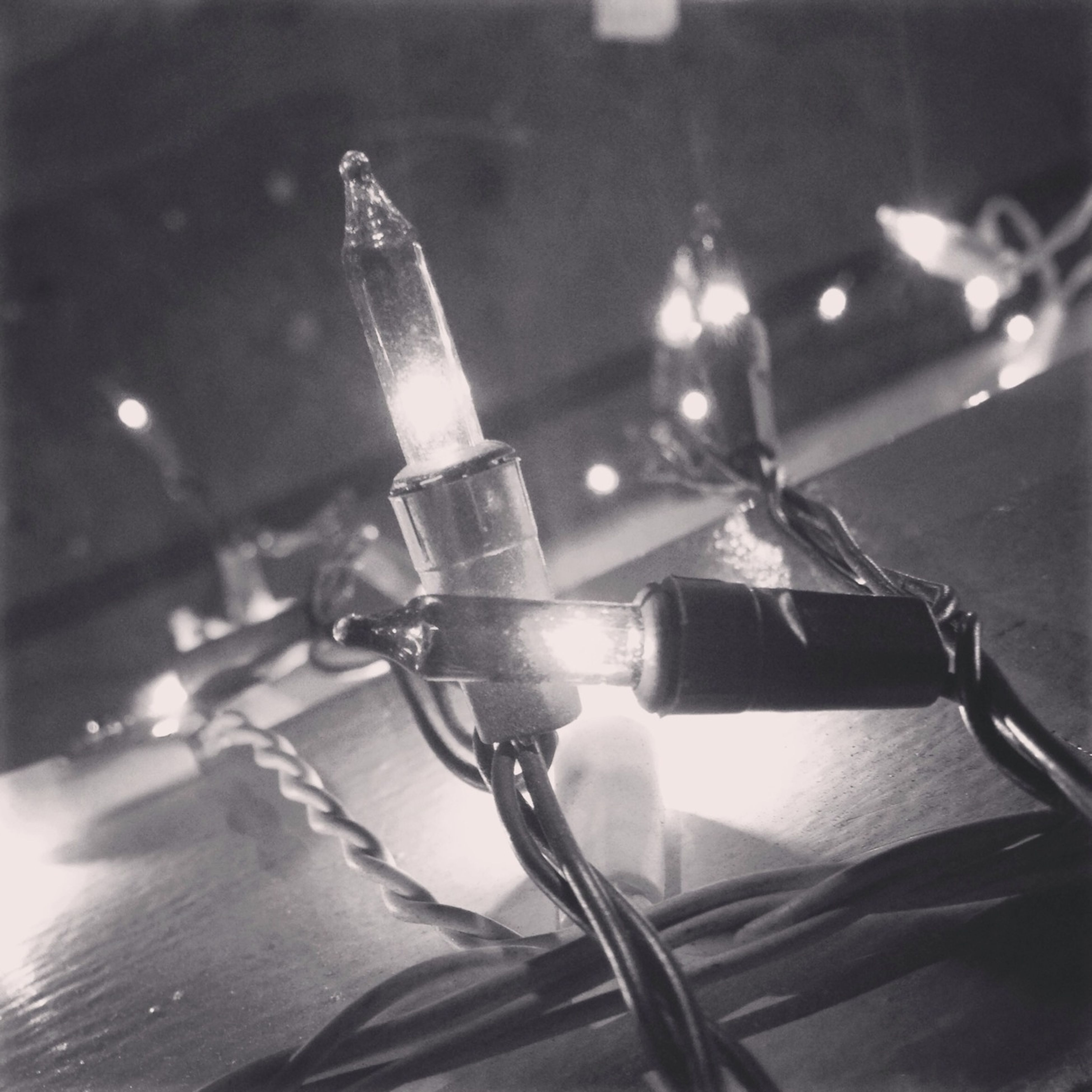 indoors, table, still life, close-up, illuminated, focus on foreground, high angle view, selective focus, home interior, lighting equipment, wineglass, no people, music, candle, food and drink, shadow, burning, decoration, musical instrument, single object