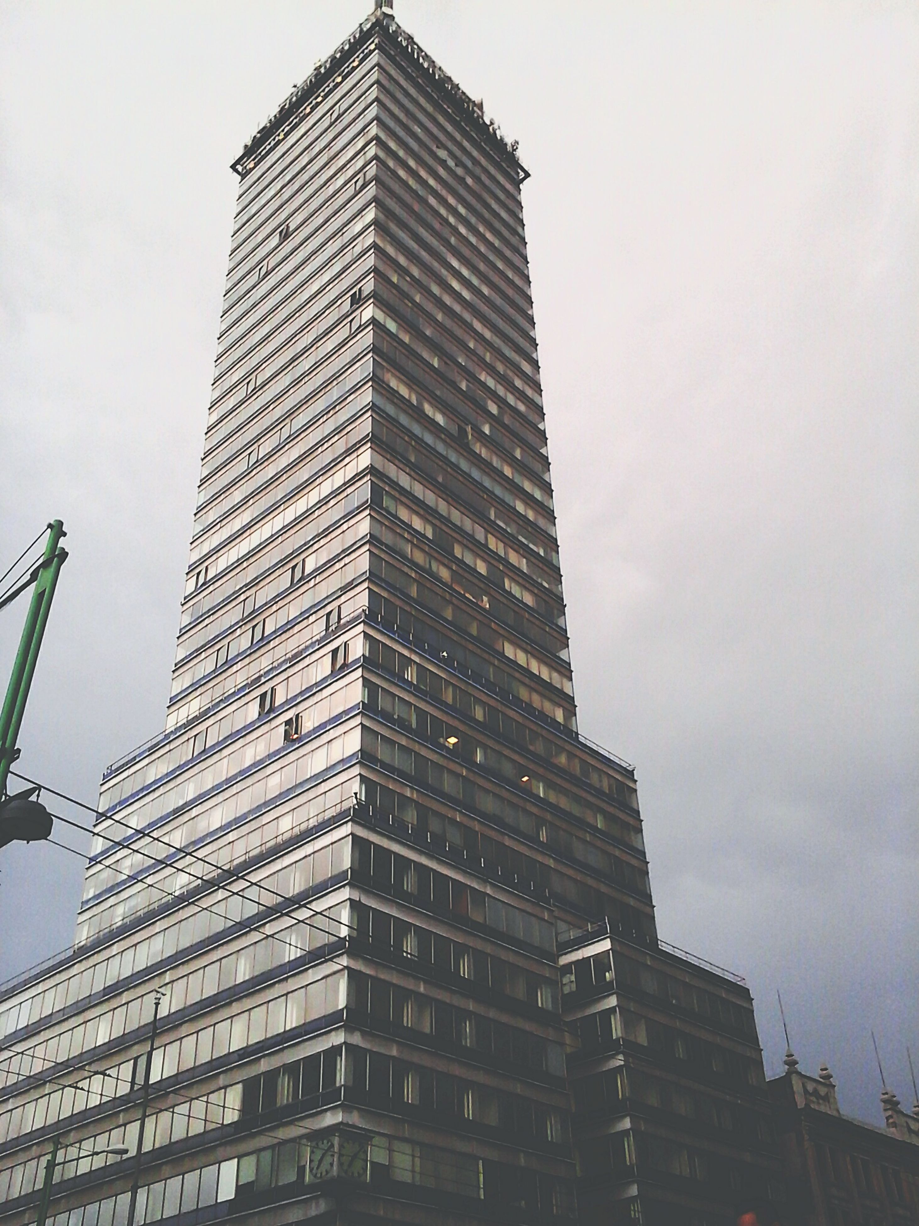architecture, building exterior, built structure, low angle view, skyscraper, city, tall - high, modern, office building, tower, sky, building, tall, development, city life, outdoors, day, no people, residential building, glass - material