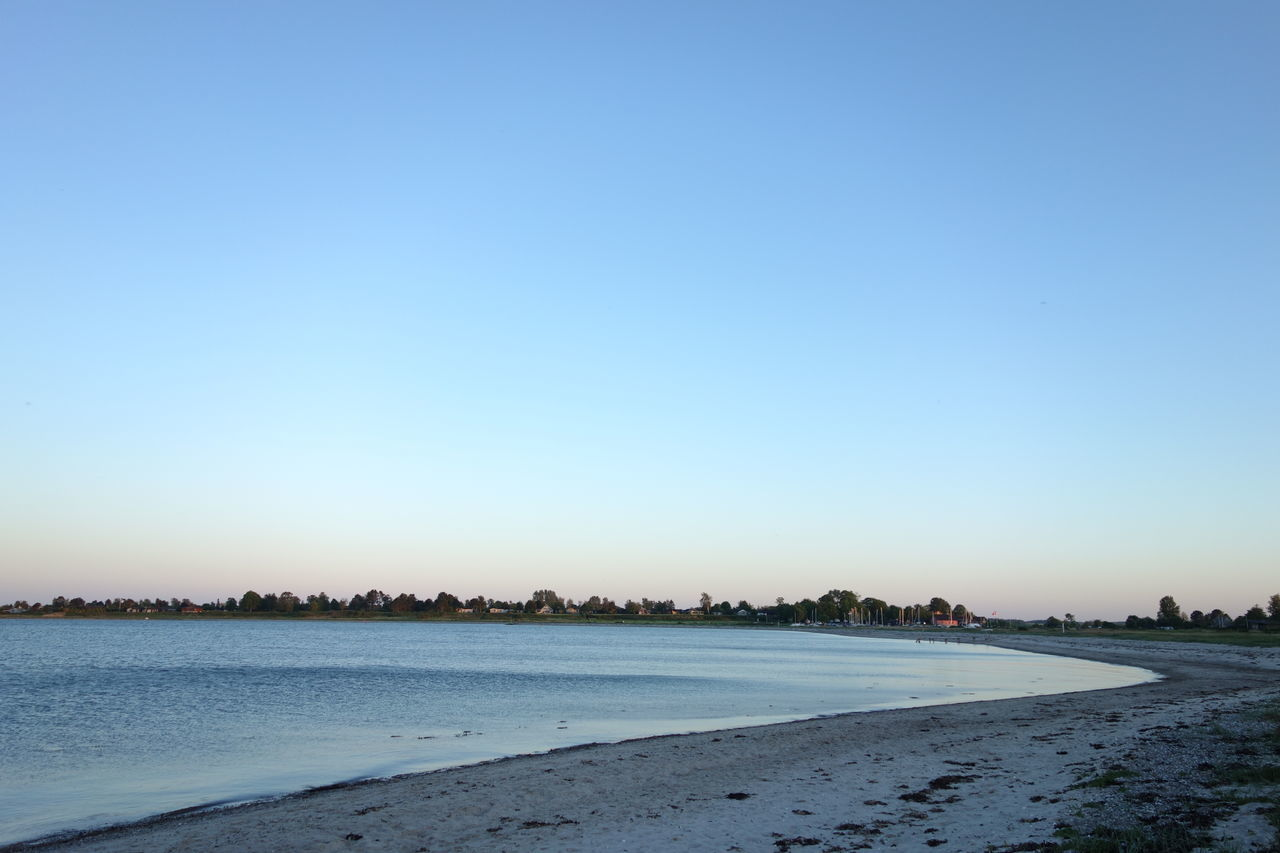 Beautiful sunset on a sandy coast. Beach Beautiful Coast Freedom Lifestyle No People NOMAD Nomadic Romantic Sky Sunrise Sunset