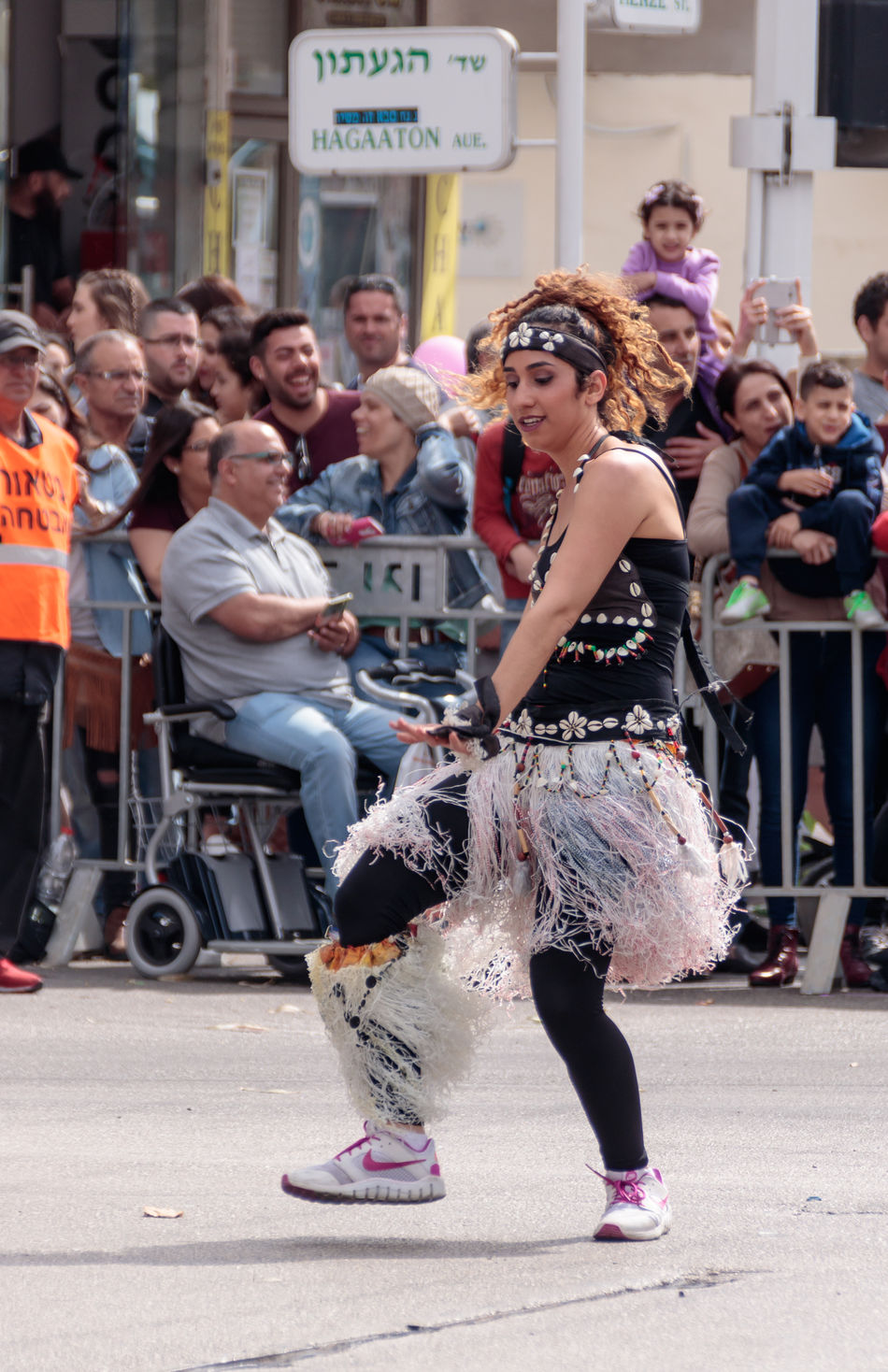 Nahariyya, Israel, March 10, 2017 : Participants at the traditional annual сarnival parade - dancer in exotic costume - dances near the viewers on the street in Nahariyya, Israel Adloyada Adult Beauty Carnival Celebration Colorful Costume Culture Day Decoration Dressed Entertainment Festival Fun Happy Israel Masquerade Nahariyya Outdoors Parade Party People Style Traditional Travel