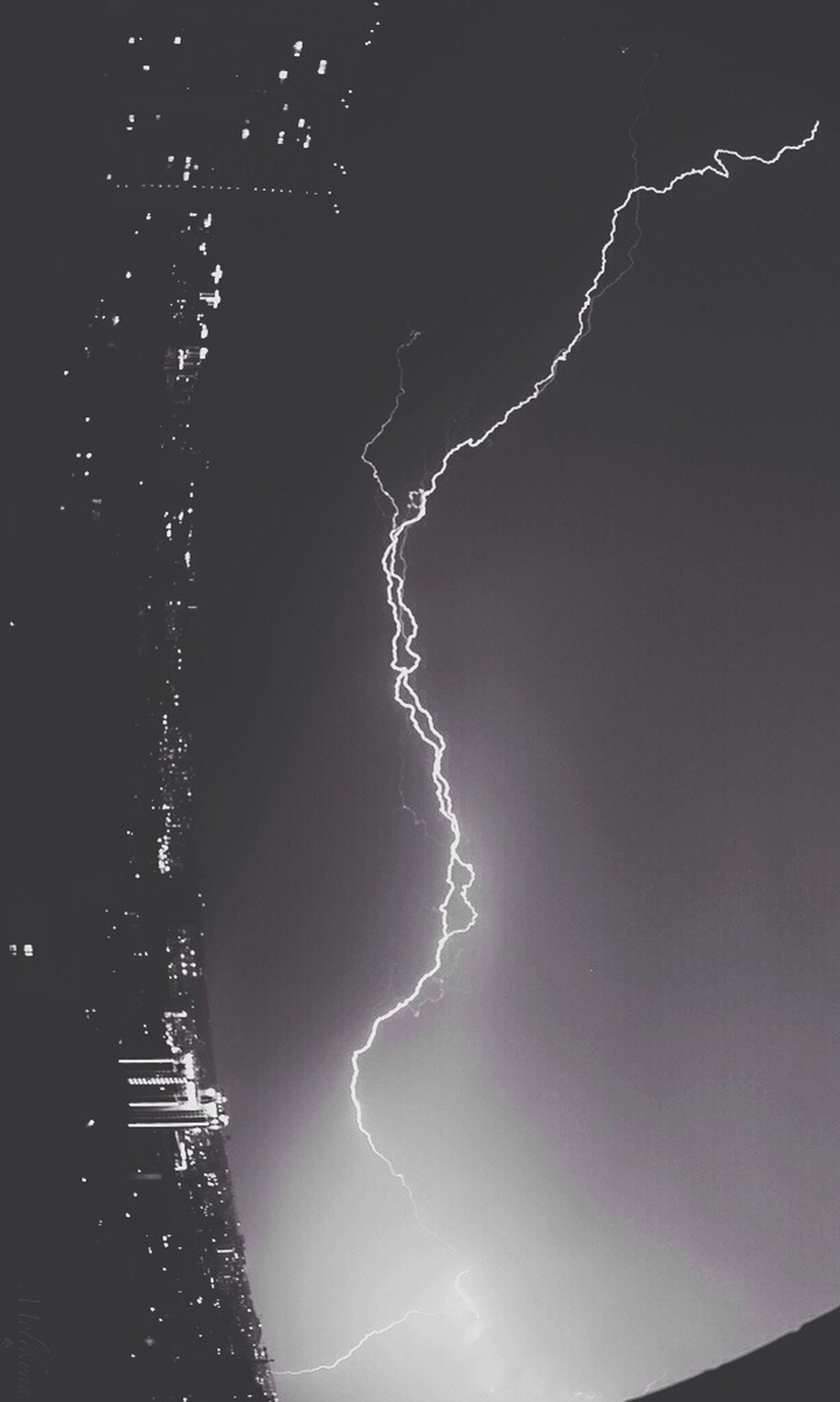 night, illuminated, low angle view, sky, electricity, nature, outdoors, beauty in nature, building exterior, no people, lightning, power in nature, built structure, thunderstorm, weather, lighting equipment, light - natural phenomenon, scenics, long exposure, light