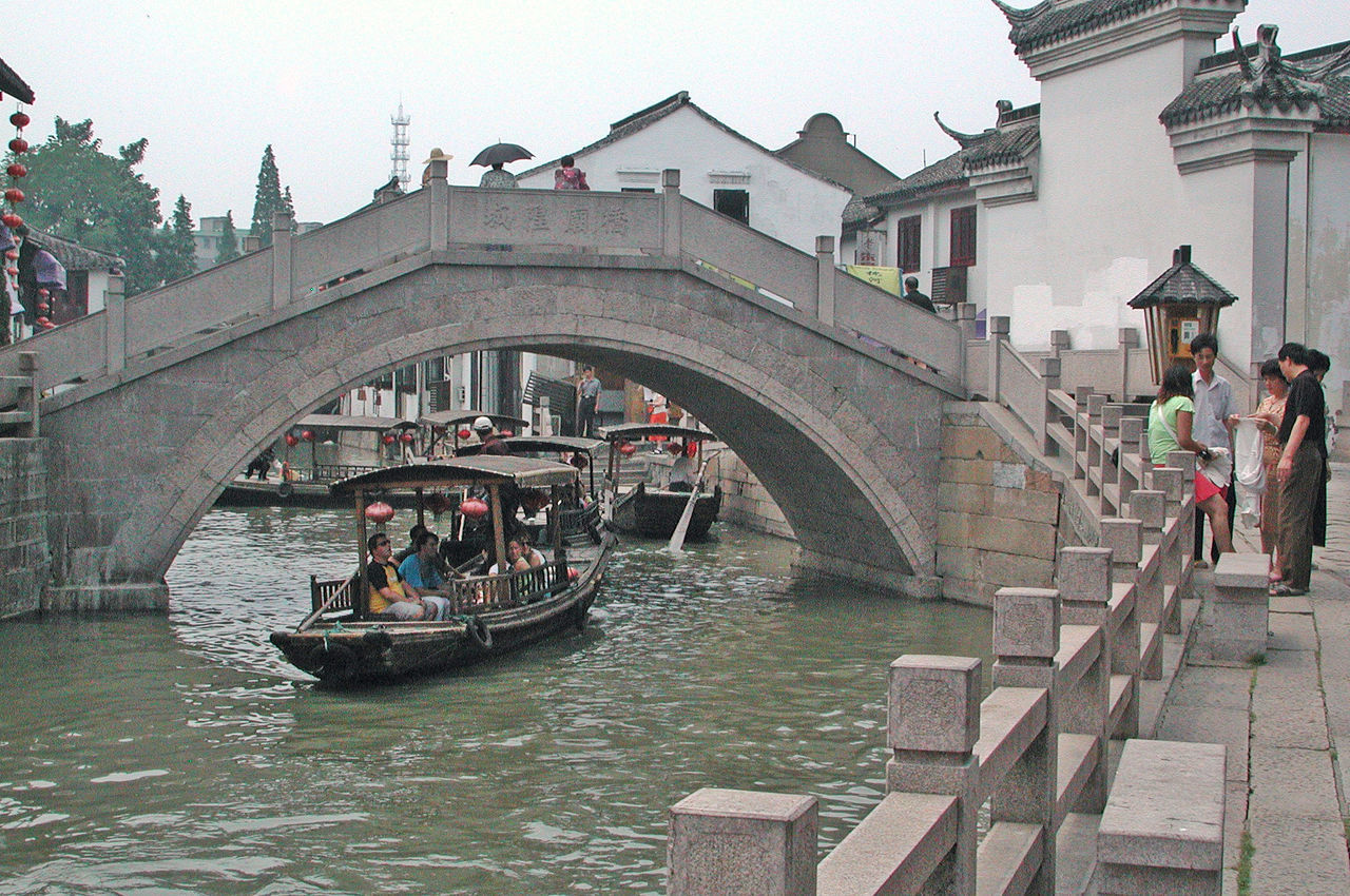Bridge over canal in watertown near Shanghai, China. Arched Bridge Architecture Boat Canal China Conversations Culture Heritage History Tourism Tourists Transportation Umbrellas Water Watertown