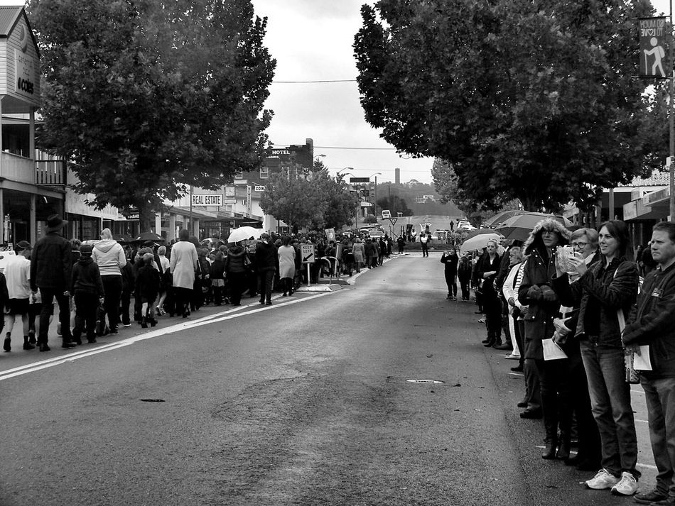 Adult Anzac Day Black And White Building Exterior Built Structure City Crowd Day Large Group Of People Lestweforget Men Monochrome Outdoors Parade People Rain Rainy Days Real People Road Sky Street Street Photography Tree Women