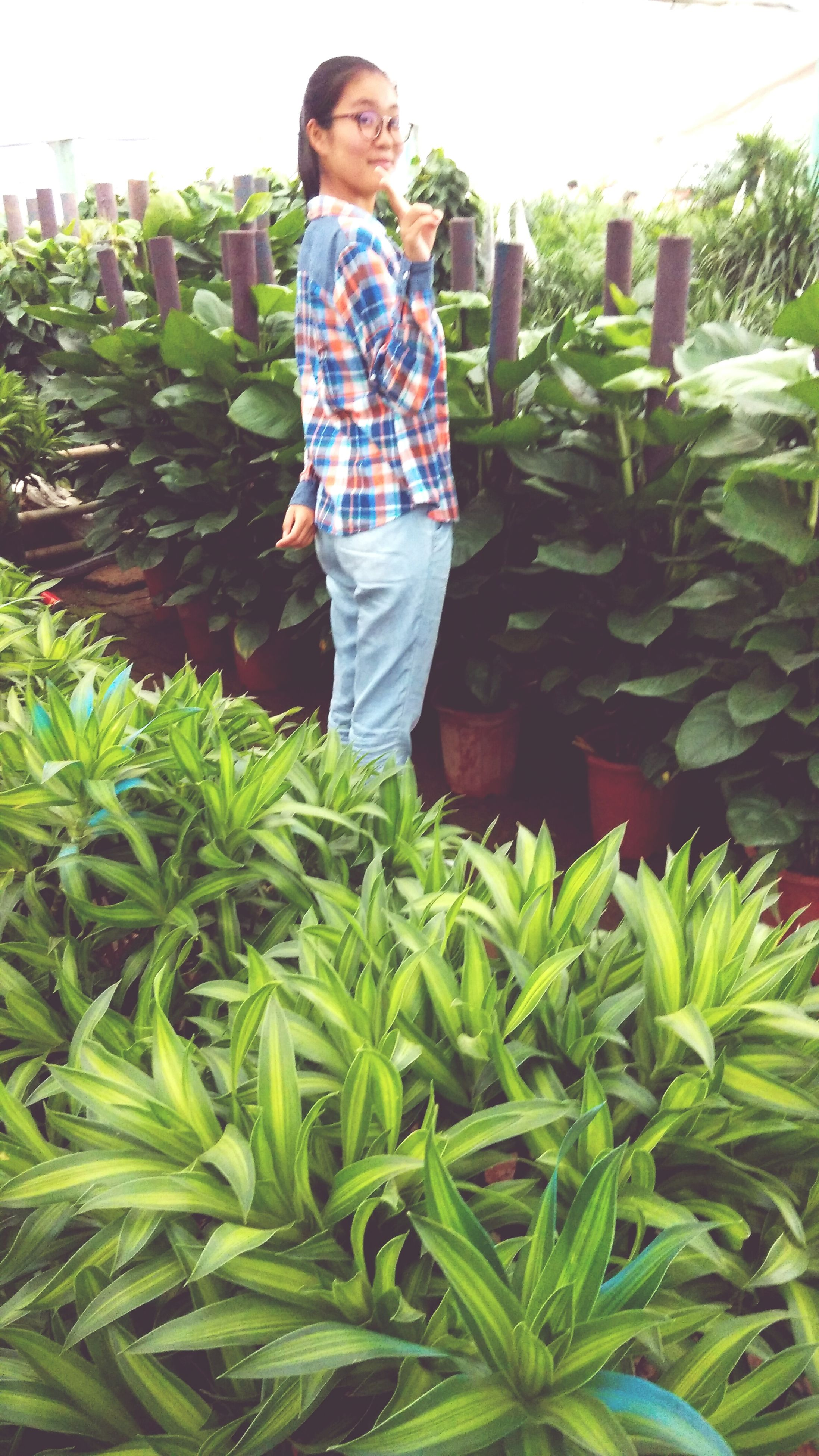 casual clothing, person, childhood, lifestyles, elementary age, leisure activity, full length, boys, green color, standing, plant, front view, cute, innocence, girls, growth, smiling, happiness