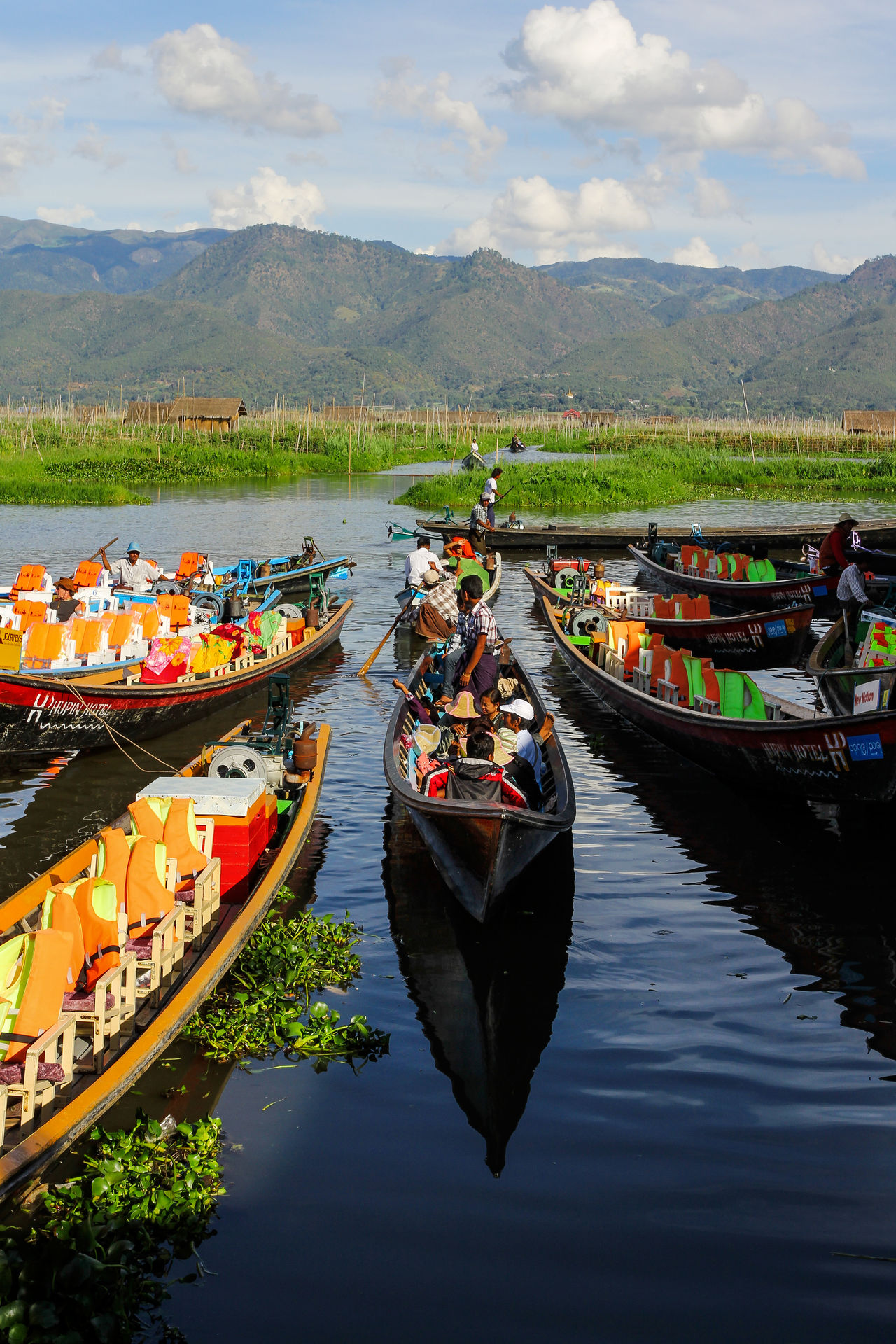 Cultures Inle Lake Leisure Activity Mode Of Transport Mountain Myanmar Nautical Vessel Non-urban Scene Outdoors Reflection Remote Rural Scene Scenics Sky Tourism Tranquility Transportation Travel Travel Destinations Unrecognizable Person Vacations Water
