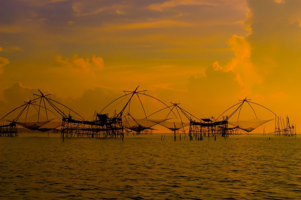 sunset, sea, water, nature, tranquility, silhouette, sky, outdoors, beauty in nature, scenics, no people, waterfront, horizon over water, built structure, architecture, offshore platform, day, drilling rig