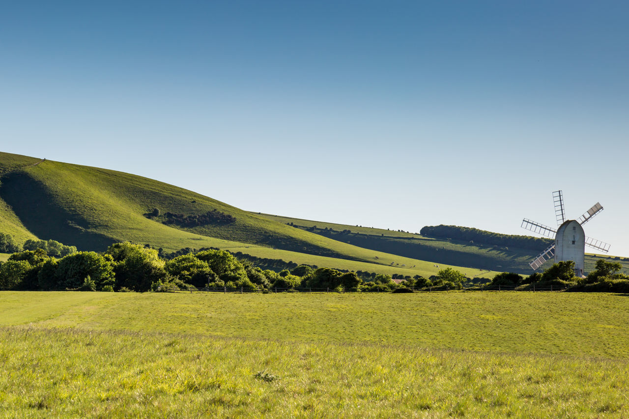 Sussex Landscape with Windmill Architecture Ashcombe Beauty In Nature Built Structure Clear Sky Countryside Day Field Grass Green Color Hill Idyllic Landscape Nature No People Outdoors Rural Scene Scenics Sky South Downs Sussex Tranquil Scene Tree Windmill Windmill