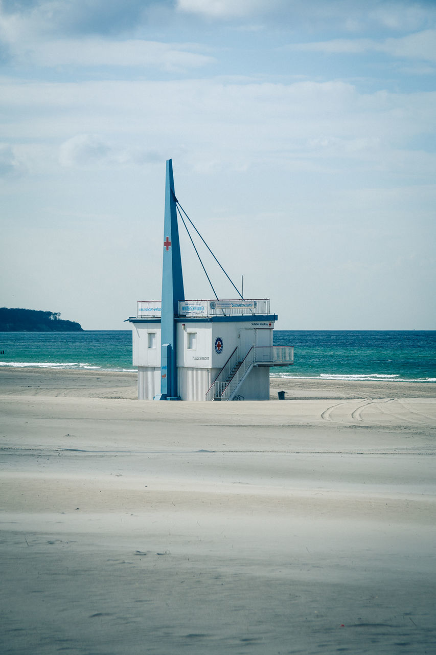 Lifeguard Hut On Sea Shore Against Sky