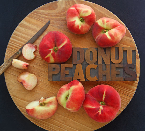 Donut peaches with words Knife Natural Light Red Textures Typography Brown Close-up Cutting Board Day Donut Peaches Doughnut Peach Font Food Fresh Fruit Healthy Eating Indoors  Letter No People Overhead Summer Text Typeface  Wood Type