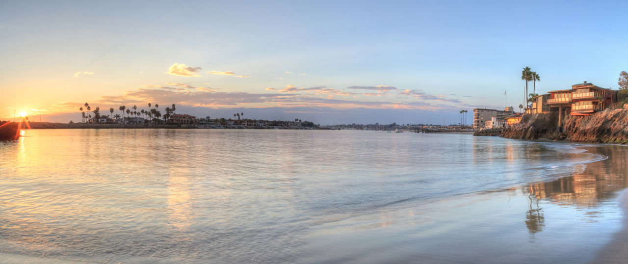 Sunset over the harbor in Corona del Mar, California at the beach in the United States Beach California Cityscape Corona Del Mar Corona Del Mar Beach Harbor HDR No People Ocean Ocean View Outdoors Panoramic Sea Sky Sunset Sunsets United States Water