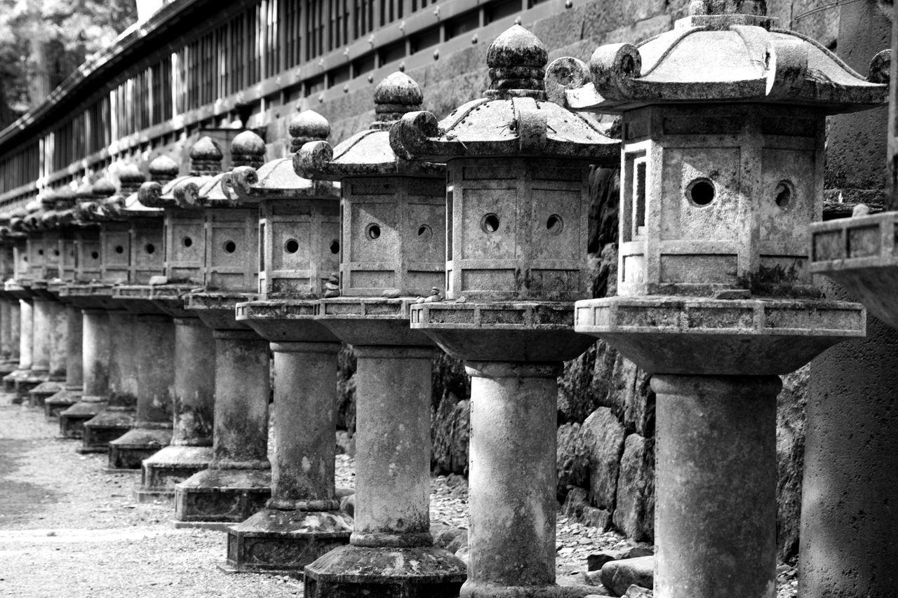 Row Of Stone Lantern At Shrine