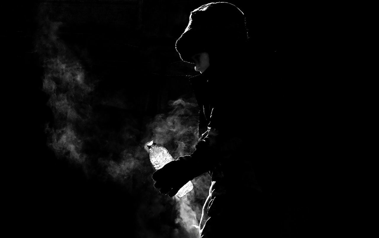 Backlight Black Black & White Bottle Boy Cold Air Darkness And Light Male Noir Et Blanc One Person Real People Silhouette Smoke - Physical Structure Steam Water Bottle  Winter Art Is Everywhere TCPM
