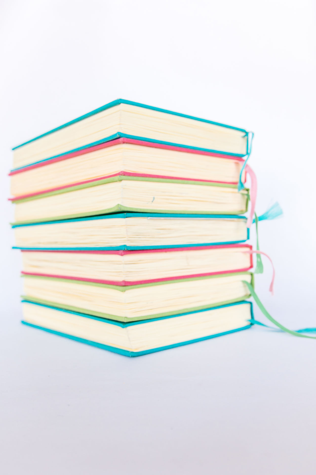 Colorful Books Blue Books Close-up Colorful Colors Cyan Education Educational Green Learning LearningEveryday Multi Colored No People Paper Pink Reading Reading Books Reading Time Stack Study Hard Study Time Studying White Background