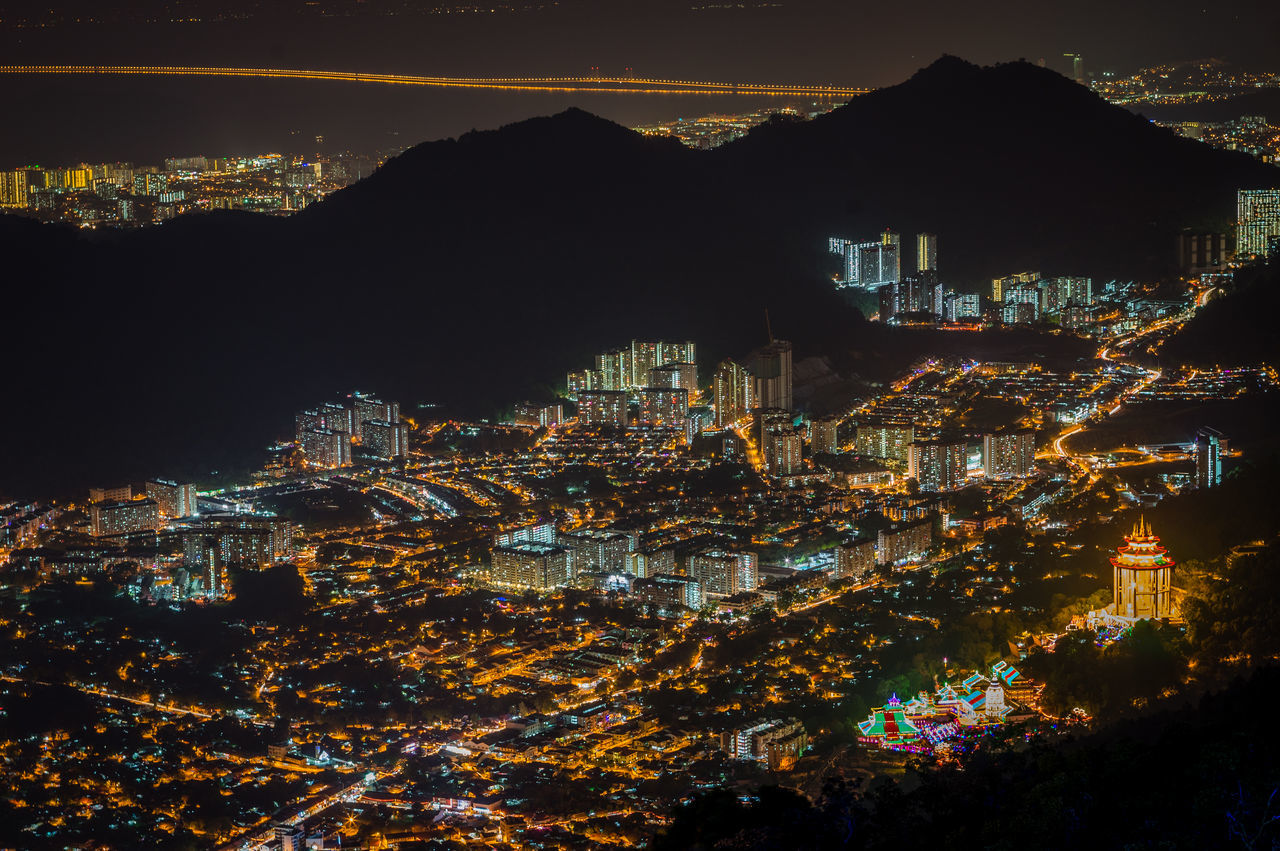 City At Night Architecture Building Exterior Built Structure City Cityscape Illuminated Mountain Nature Night No People Outdoors Residential Building Scenics Sky Skyscraper Travel Destinations Neon Life