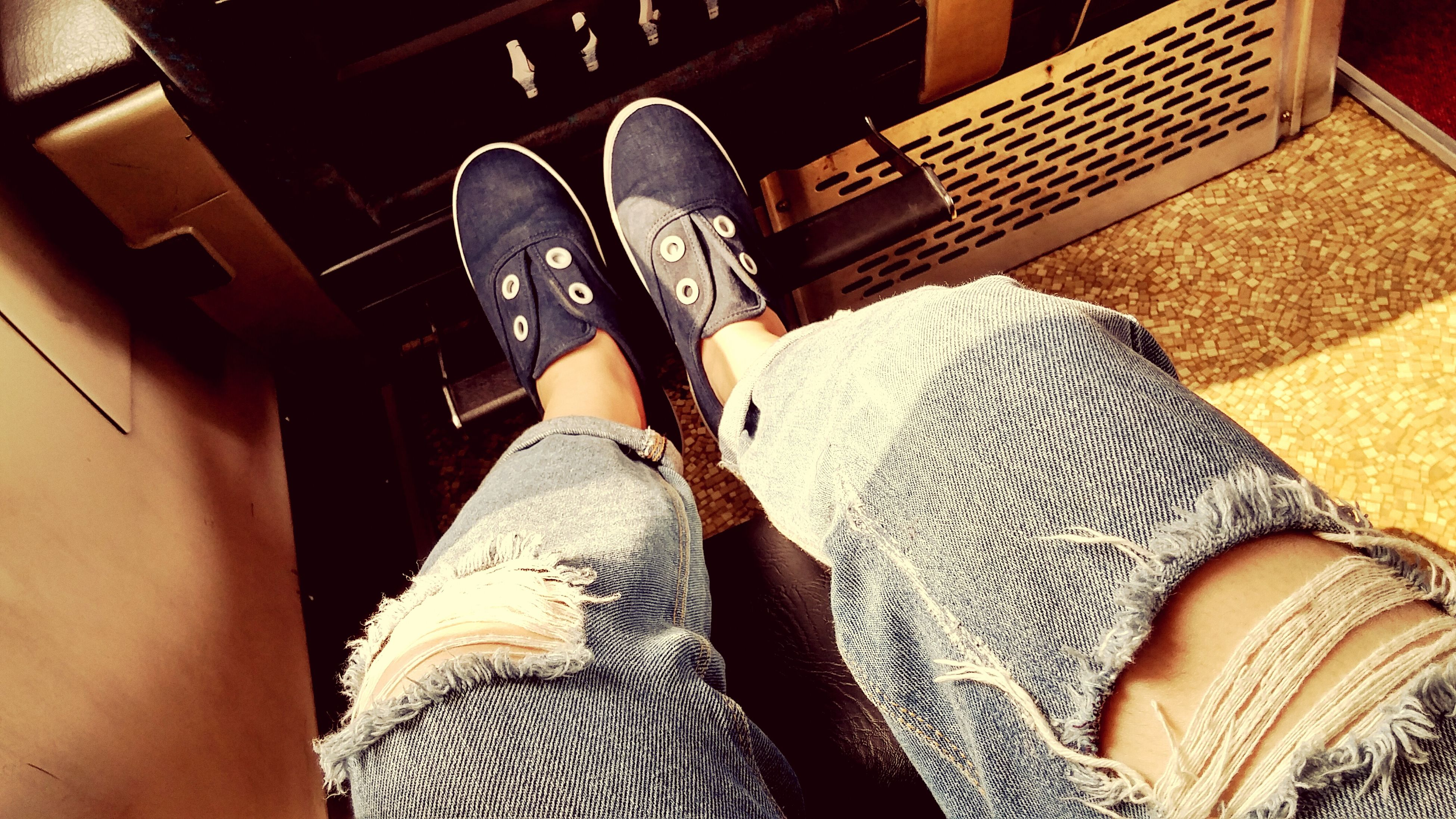 low section, person, shoe, lifestyles, personal perspective, human foot, sitting, leisure activity, jeans, casual clothing, indoors, standing, relaxation, high angle view, footwear, men