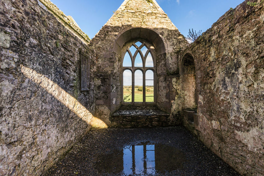 14th Century Abbey Ruins Arch Architecture Building Exterior Built Structure Clear Sky Day Historical History Ireland Medieval No People Old Ruin Outdoors Quin Abbey Reflection Sky The Past Travel Destinations Water Window Window View