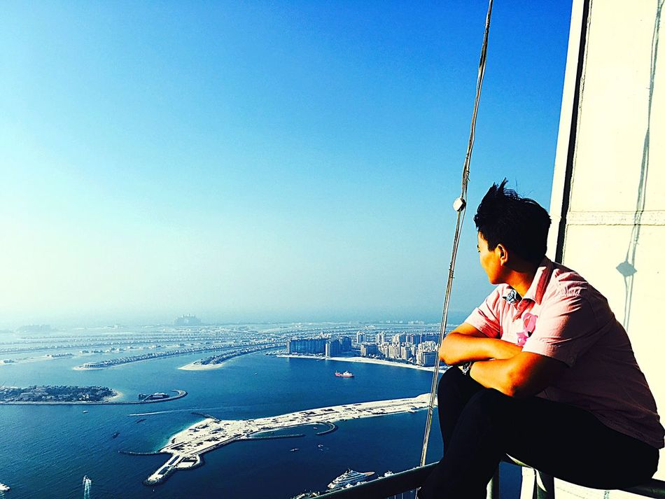 My Year My View Clear Sky Real People Lifestyles Blue Sea One Person Sky Leisure Activity Water Horizon Over Water Young Adult Outdoors Nature Day Technology Adult Cayantower Dubai❤ Atlantis_The_Palm Overlooking