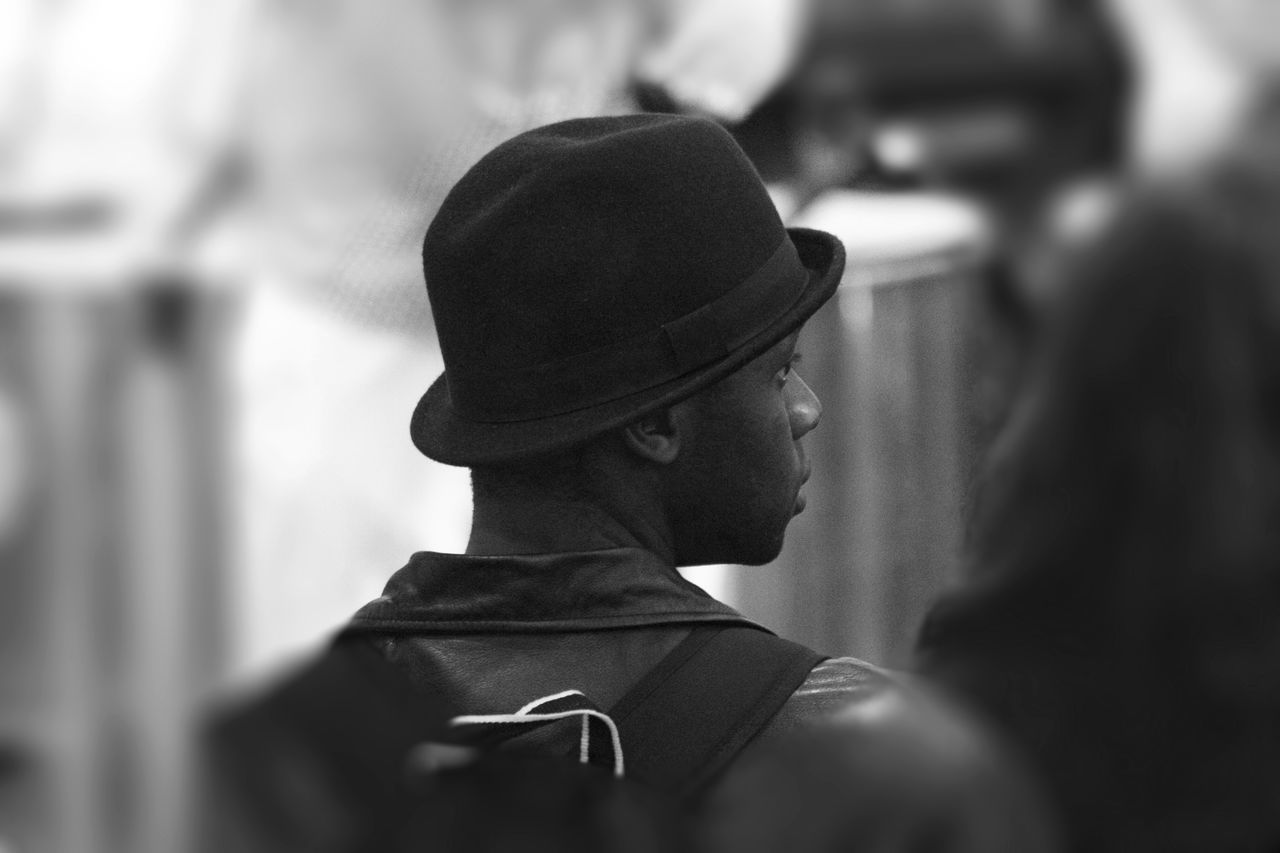 Music fan in Bowler Hat Backpacking Bowler Hat Close-up Day Fashion Fashion Focus On Foreground Hat Headshot Indoors  Jazz Music Leather Jacket Lifestyles Music Fan One Person Real People Selective Focus Women Young Adult Young Women