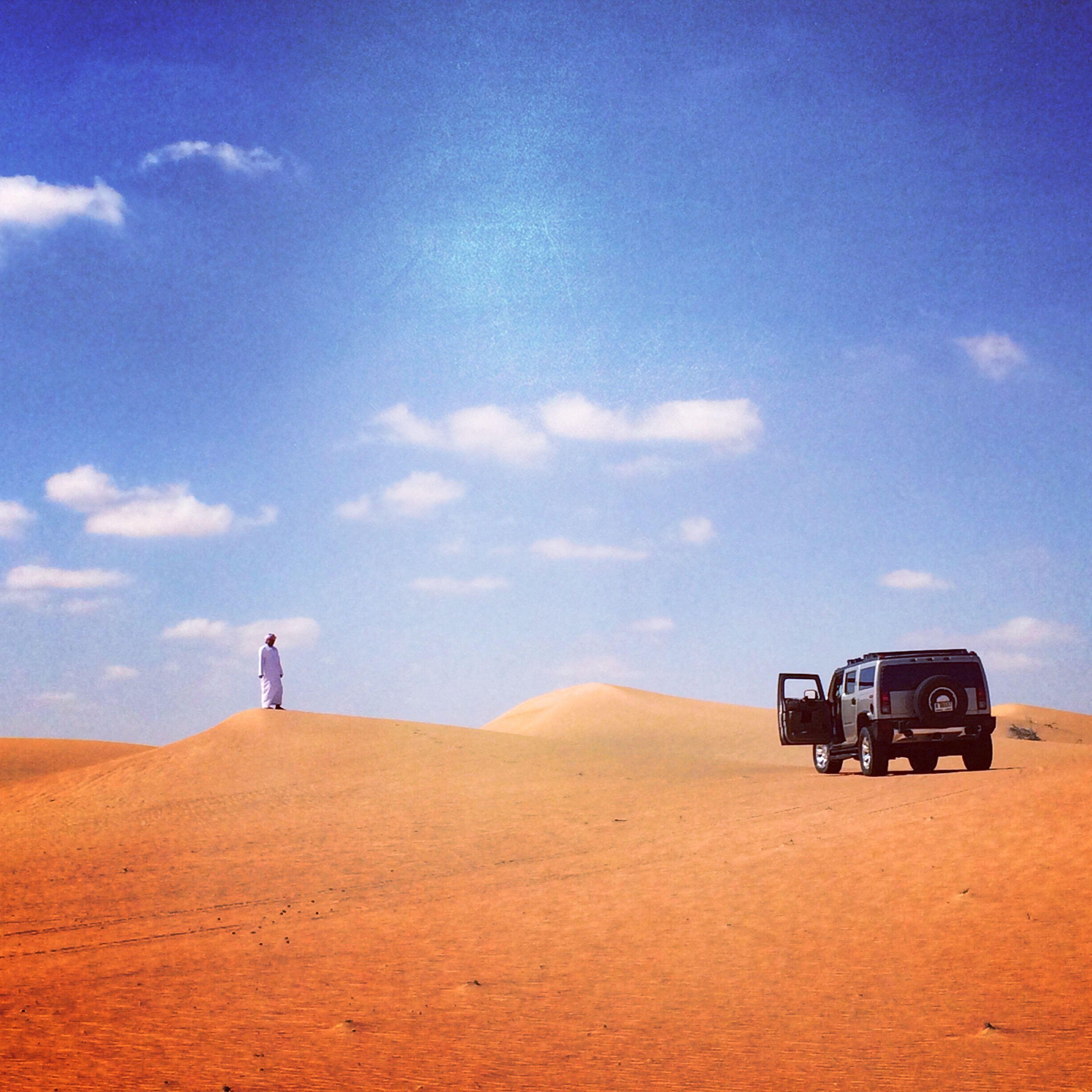 sky, landscape, sand, men, cloud - sky, cloud, mountain, desert, rear view, lifestyles, tranquil scene, leisure activity, nature, transportation, travel, tranquility, land vehicle, scenics