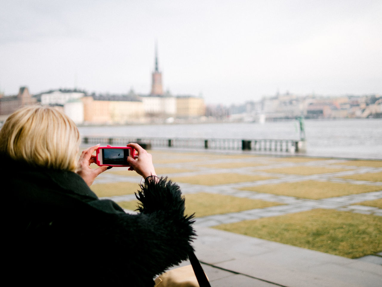 stockholm, gamla stan in background Camera - Photographic Equipment Gamla Stan Photography Themes Smart Phone Stockholm Water Wireless Technology Women