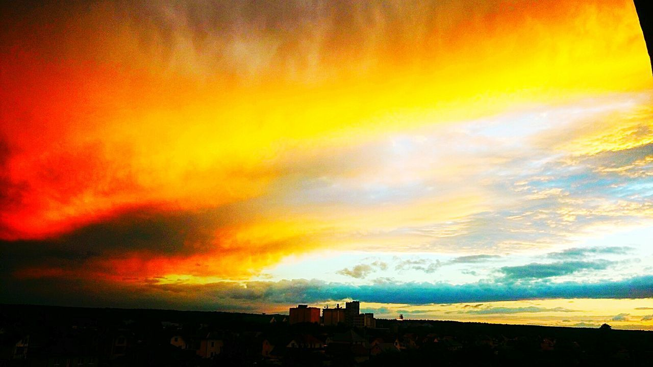 sunset, sky, cloud - sky, dramatic sky, orange color, beauty in nature, scenics, nature, silhouette, built structure, multi colored, tranquil scene, outdoors, building exterior, no people, yellow, tranquility, architecture, tree, day
