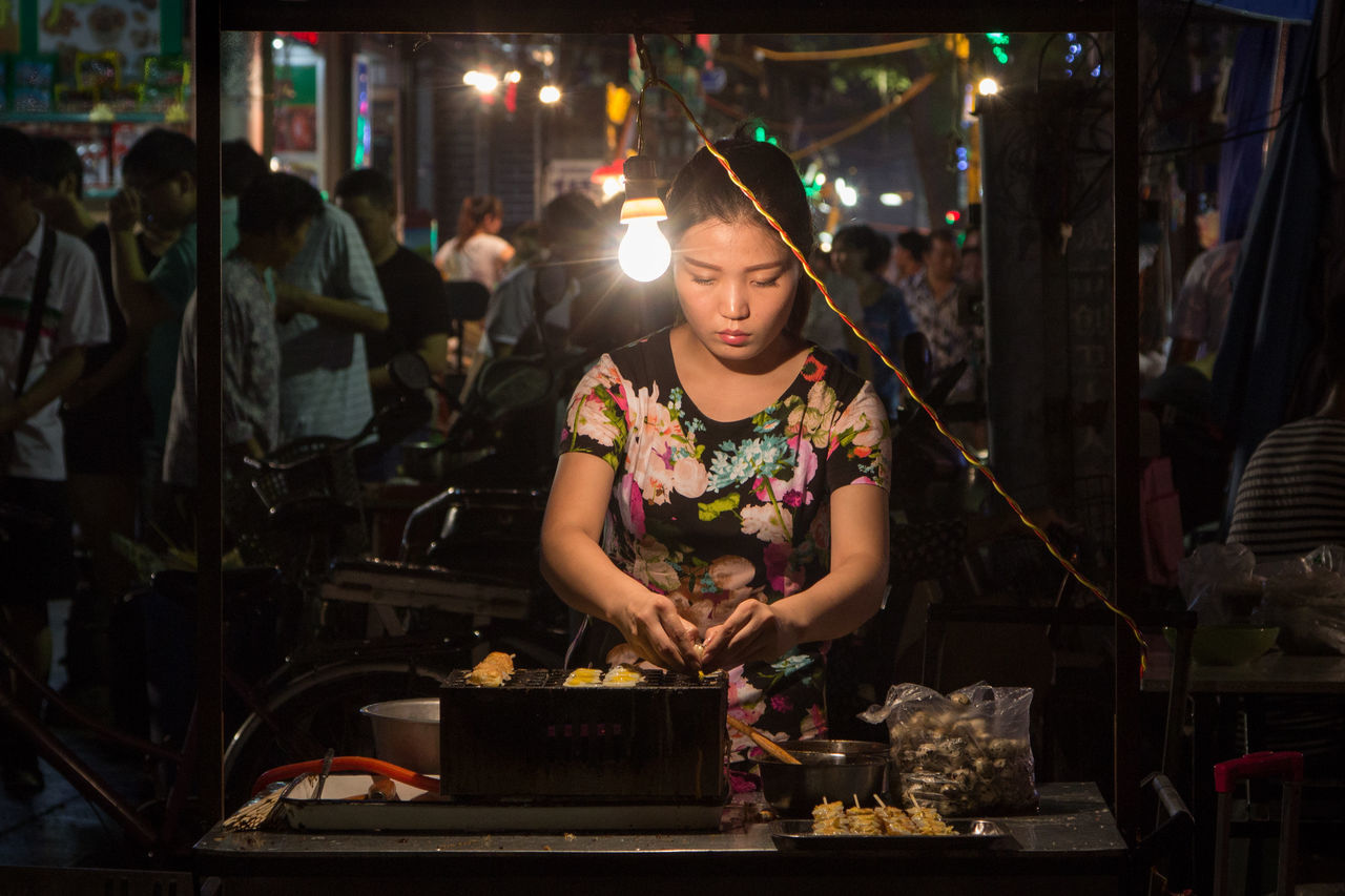 Quail eggs are on the menu tonight as one vendor sells the treat at the Xi'An night market. China Chinese Cuisine First Eyeem Photo Food Lifestyle Night Market Silk Road Street Street Food Streetphotography Travel Vendor Xian Xian China